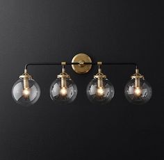 RH Modern's Bistro Globe Bath Sconce 4-Light:Inspired by 1940s industrialism, our globe sconce's lines and spheres are reminiscent of an urban subway map.