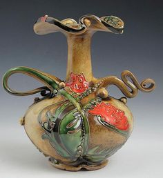 The spirals, swirls, scrolls and waves of Carol Long's pottery.