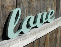 Wooden Love Sign - Wood Words - Cut Out. $45.00, via Etsy. I got 3 signs made and had my friends and family sign them with permanent markers as our guest book.