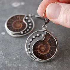Fossilized spiral..earrings with ammonites. Circle diameter is 2.7 cm, length earrings with hook 4.8 cm. Hook to close. Czech jewelry