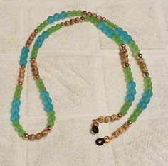 This custom made Eye glass chain is 26 inches in length Beaded Eyeglass Chain made with beading wire and Turqouise Beach Glass, Peridot Beach Glass and Golden Brown Czech Glass beads and Gold Space. Czech Glass Beads, Glass Jewelry, Peridot, Eyeglasses, Jewelry Making, Jewels, Chain, Gold, Ideas