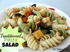 Easy Traditional Pasta Salad. No summer BBQ or potluck is complete without this dish! SixSistersStuff.com #recipe #salad #pasta