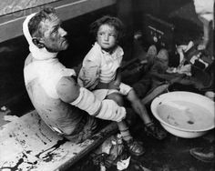 Father and Daughter Wounded in Air Raid Over Warsaw, 1939 - HU040407 - Rights Managed - Stock Photo - Corbis