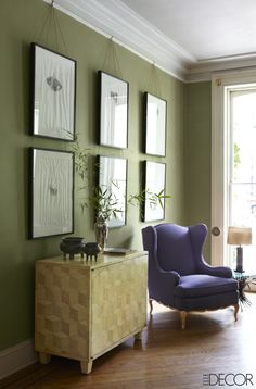 In furniture restorer Karl Kipfmueller's Brooklyn townhouse, the living room features a parchment cabinet by Grand Avenue Workshop and a purple armchair that once belonged to his grandmother.   - ELLEDecor.com