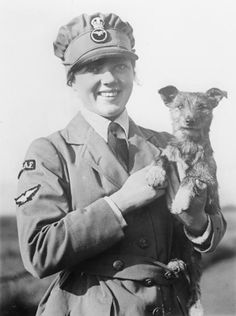 Women's Royal Air Force rating with her dog, WWI