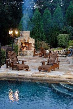 Backyard. Fireplace. Pool. Stone.                                                                                                                                                                                 Mais