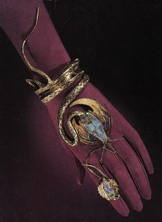 An Egyptian revivalist style bracelet and ring.