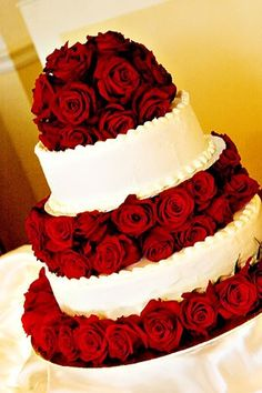 Wow! Lush red rose wedding cake. I would LOVE to make 1of these for a special wedding.