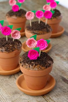 Flowerpot Cupcakes, chocolate devil's food cake baked in mini terracotta flower pots, topped with frosting, Oreo crumbs and pretty paper flowers to mimic flowerpots! - http://ThisSillyGirlsLife.com #FlowerpotCupcakes