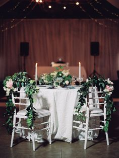 Garland draped reception chairs