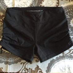 Victoria's Secret Knockout Shorts Black Victoria's Secret knockout shorts. Rucking on the sides on the shorts for a flattering look (see pictures). Great for working out. Small hidden pocket for keys, etc. excellent condition! Victoria's Secret Shorts