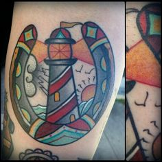 Traditional light house and horse shoe tattoo by Zack Taylor at Evermore Tattoo in Los Angeles, CA