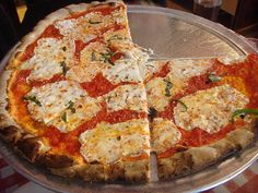 Lombardi's Pizza since 1897- 32 Spring St  New York, NY 10012  Corner of Spring and Mott Street (the number 6 subway line is only a block away), Nolita, Clam pie, Margherita pie
