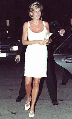 1995 | What happened to Shy Di? The princess began to favor sheath dresses that showed off her slim shape, like this white Versace number she wore for a charity concert in Italy. | InStyle 18