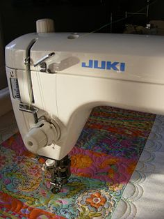 Spring strippy table runner on the New English Quilter frame with the JUKI TL98P