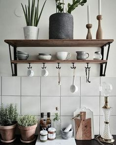 100 Stunning Farmhouse Kitchen Decor Ideas You Have to Try - You have to see this #farmhousekitchen decor idea with dark kitchen countertops and porcelain kitchenware. Love it! #FarmhouseKitchen #HomeDecorIdeas