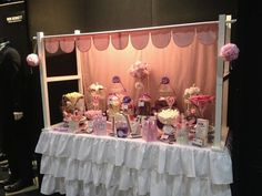 A little too frilly for us but I like the wood frame and scalloped trim up top. A nice warm, enclosed space.  candy booth