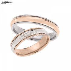 http://www.lemienozze.it/operatori-matrimonio/gioielli/gioielleria-frosinone/media/foto/8  Fedi nuziali in oro rosa con diamanti