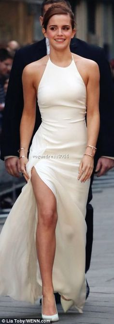 She walked towards the Leicester Square cinema in a striking white frock, slit to the thigh. Gosh, she looked smart  #promdress
