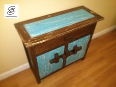 A very retro cabinet! Distressed to perfection! By the way, the door latches are handmade out of wood!