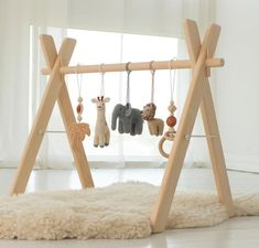 Safari baby play gym - Wooden baby gym with toys - Infant activity center - African animals. Baby shower gift, Una parte essential environnant les new york evolución p united nations bebé es los angeles e. Baby Room Design, Baby Room Decor, Boy Room, Kids Room, Wood Floor Texture, Diy Bebe, Baby Play, Baby Boy Toys, Wooden Baby Toys