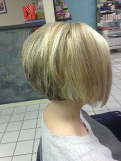 Short angled bob. Blonde highlights and dark golden blonde lowlights. Salon A Go-Go