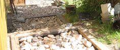Regnvandsopsamling i haven – og tørre fødder