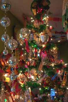 A look at the back of the tree and the disco balls that are hanging from the ceiling.