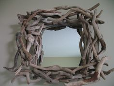 Beautiful African driftwood mirror made from wood found in the Indian Ocean.