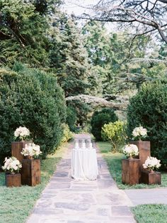 Love the idea of three graduated wood pedestals at beginning of aisle