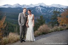 The Lodge at Breckenridge Bride and Groom with ski resort views Photo by: April O'Hare