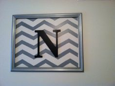 Chevron painted on wall with painted frame & wooden letter