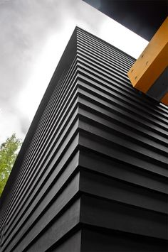 Exterior wall cladding made from the sustainable building material Richlite. Richlite eco-friendly paper-based fiber composites are distributed by Intectural. Residence designed by Salmela Architect