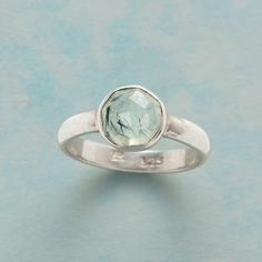 RUTILE IN THE ROUND RING--Facets offer multiple glimpses inside round, domed rutilated prehnite, revealing the inclusions unique to each stone. A ring handcrafted in sterling silver exclusively for us. Whole sizes 5 to 9.