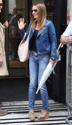 Fans:The Bag It Up star toted a blush pink bag and, keeping her protected from the elemen...