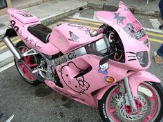 hello kitty motorcycle!  My Daddy would shake his head in shame...me on a pink hello kitty bike. He would beam if it was a Harley.