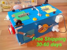 Busy Board Activity Board busy box Sensory Board by BusyBoardOlga Sensory Wall, Sensory Boards, Latch Board, Busy Boards For Toddlers, Busy Boxes, Gross Motor Skills, Activity Games, Business For Kids, Diy Toys