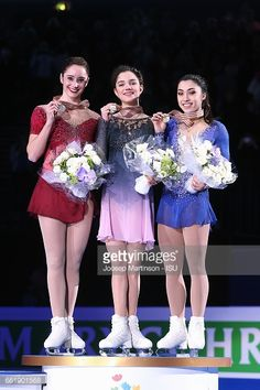 HELSINKI, FINLAND - MARCH 31: (L-R) Kaetlyn Osmond of Canada, Evgenia Medvedeva of Russia and Gabrielle Daleman of Canada pose in the Ladies medal ceremony during day three of the World Figure Skating Championships at Hartwall Arena on March 31, 2017 in Helsinki, Finland. (Photo by Joosep Martinson - ISU/ISU via Getty Images)