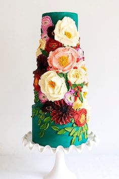 colorful wedding cakes As if we couldnt possibly love cake any more, these gorgeous winter cakes make our love go just that much deeper. With breathtaking details and creative surprises, these winter cakes are sure to cure your winter weather blues! Wedding Cake Prices, Fall Wedding Cakes, Beautiful Wedding Cakes, Gorgeous Cakes, Wedding Cake Designs, Pretty Cakes, Fabric Roses, Floral Cake, Wedding Colors