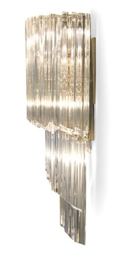 For sale on a shimmering pair of large sconces in a mirrored form of a twisting cascade of quatrefoil shaped crystal rods by camer