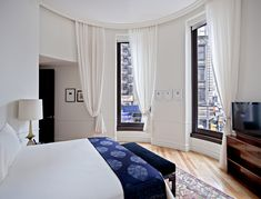 curved wall and curtains- The NoMad Hotel