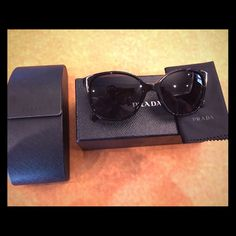 PRADA Square Frame Sunglasses PRADA square frame polarized sunglasses. Plastic black square frame. Polarized grey-black lenses. Perfect condition, practically brand new Prada Accessories Sunglasses