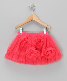 "A ""must"" for the wardrobe. This frilly tutu has plenty of texture thanks to its ample rows of ruffles and rosette accents. That means this detailed piece works great with any solid top or tank because it pulls its own weight for style. 100% polyesterHand wash; hang dryImported"