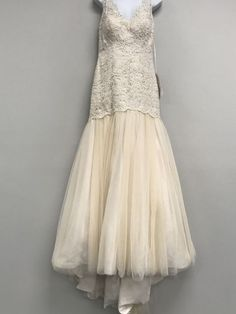 Stella York wedding dress currently for sale at 82% off retail.