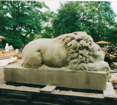 Sand Stone #sculpture by #sculptor Martyn Bednarczuk titled: 'Lion (Carved Classical stone After Cannova garden/Yard statue carving)'. #MartynBednarczuk