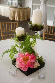 Reception flowers and decor: glass candle holders with moss, fern and roses adorned with coral peonies - Piedmont Park Garden Tent www.anikdesigns.com