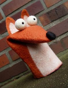 Felted fox or a cute dog, either way he is an expressive chap.