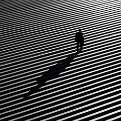 Rui Veiga's striking street photos explore the dramatic interplay of light and shadow. #photography