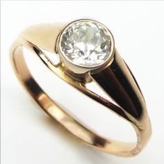 The Russian Rose: What a find! We were delighted to discover Soviet hallmarks on the shank of this sculptural and streamlined rose gold ring. A smooth bezel protects the twinkling antique diamond. Ca.1938. Maloys.com