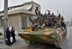 Raids kill dozens in Syria's Idlib, army advances in Aleppo